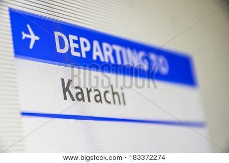 Computer screen close-up of status of flight departing to Karachi, Pakistan