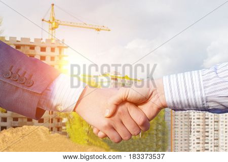 Handshake On The Background Of Construction.