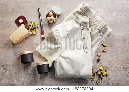 Composition with spa uniform on grunge background