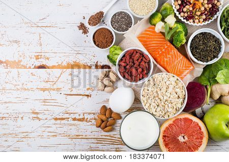 Selection of superfoods on rustic background, copy space