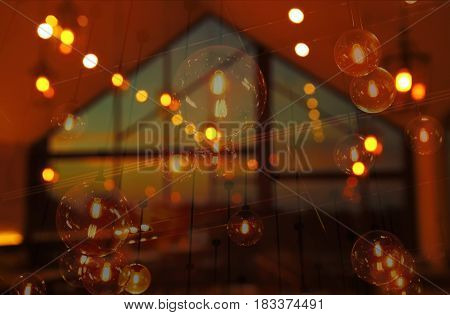 blur pub or bar with light of hanging lamp at night background