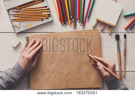 Creative artist workspace top view. Background of painting and drawing, art stationery