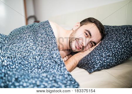 Young Man Is Happy To Sleep In His Warm Bed At Home