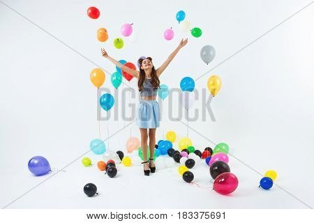 Dancing place. Stylish young girl celebrating birthday dancing, having fun in big decorated room