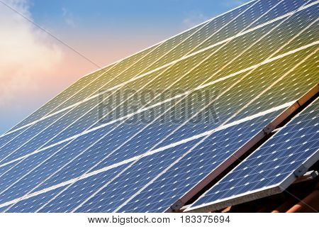 Solar panel with reflection of sunset, horizontal picture