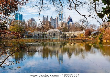View of Lake Clara Meer Piedmont Park Aquatic Center and Midtown Atlanta in sunny autumn day USA poster