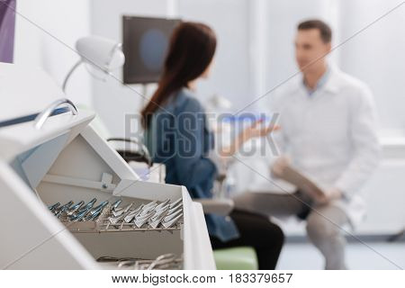 It is in order. Silhouettes of two people sitting opposite each other, patient actively gesticulating while telling the problem to her doctor