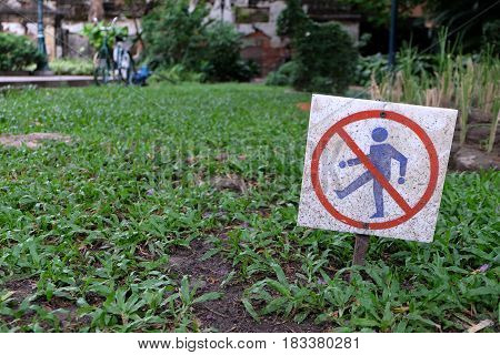 Keep Off the Grass Sign in The Garden.
