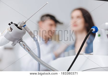 It gives light. ENT instrument being in support helping doctor to treat patients
