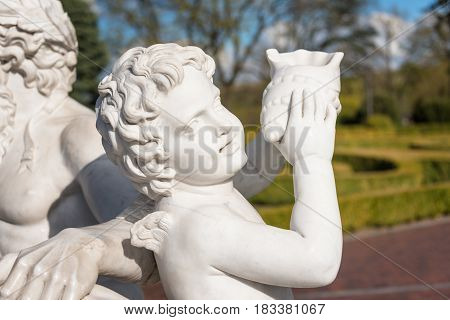Statue of cupid with shell in the park