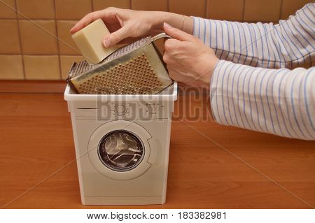 Woman shredding soap to make his own laundry detergent
