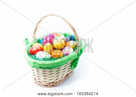 Wicker Straw Basket Of Easter Eggs Hand Painted In Home - Abstract Different Colors, Isolated In Whi
