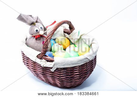 Easter Bunny With Different Kinds And Colors Of Hand Painted Easter Eggs Isolated In White Backgroun