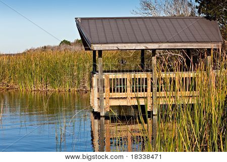 Boardwalk and look out tower on Florida Lake poster
