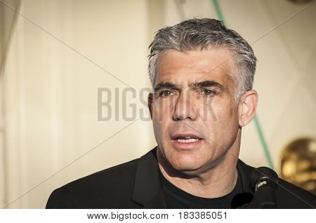 TEL AVIV, ISRAEL. April 22, 2014. Israeli politician Yair Lapid, former Finance minister and a chairman of Yesh Atid party, giving an address to the Israeli businessmen at a conference in Tel Aviv.