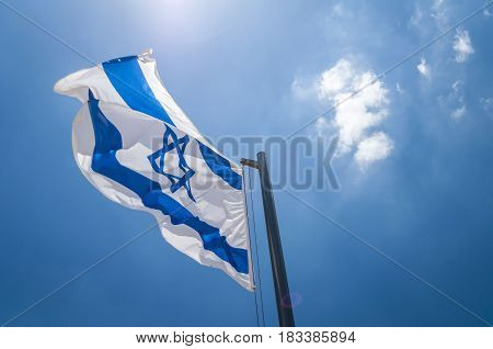 HERZL MOUNT, JERUSALEM, ISRAEL. June 2016. The flag of Israel in the blue sky stock image. Yom Haatzmaut, Israel Independence Day.