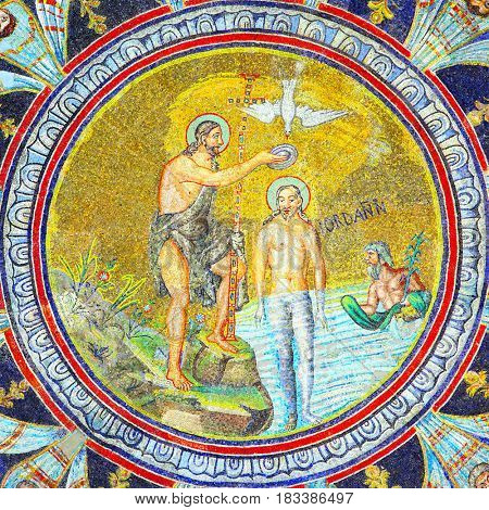 Ravenna, Italy - October 14, 2016. John the Baptist baptizing Jesus - mosaic in the Neoniano Baptistery in Ravenna (4th - 5th century), Italy.