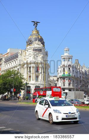 Madrid, Spain - September 01, 2016: Road traffic near The Metropolis building in Madrid