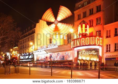 Paris, France - March 4, 2011:  The Moulin Rouge (Red Mill) cabaret at night in Paris, France