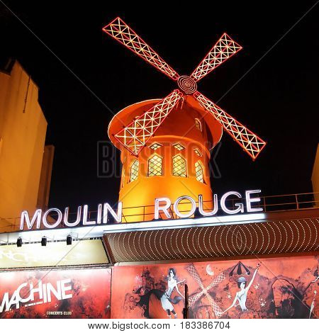 Paris, France - March 04, 2011: The Moulin Rouge (Red Mill) cabaret at night in Paris, France