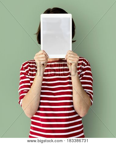 Adult Woman Face Covered with Blank Tablet