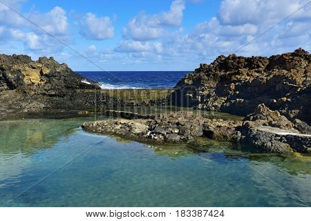 a view of the natural pools of seawater in Charco del Palo, Lanzarote, Canary Islands, Spain