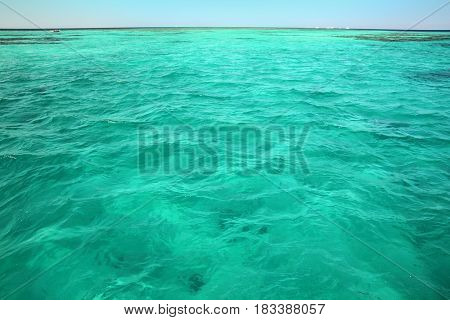 view from ship on turquoise sea water surface background