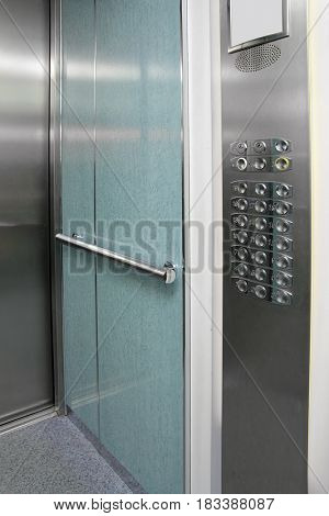 contemporary elevator interior with control panel and steel doors