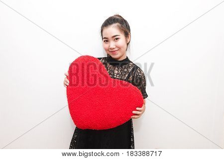 Beautiful Woman Is Hold Heart Pillow And Smiling Look Like Happy, In Love Concept.