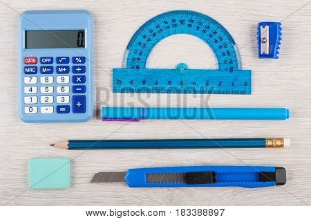 Different Blue Stationery Tools On Wooden Table