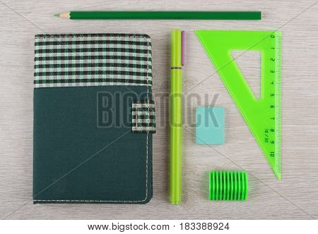 Different Stationery Tools On Light Wooden Table