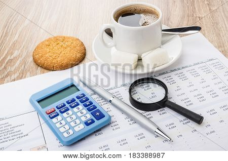 Financial Printout, Calculator, Pen, Magnifying Glass, Coffee And Cookies