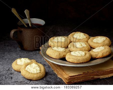 Healthy Peanut Butter Cheesecake Thumbprint Cookies. Delicious Homemade Shortbread And Cup Of Tea On