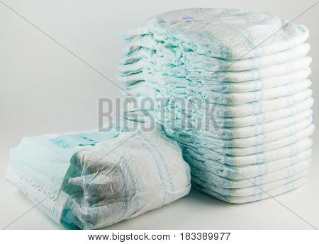 Baby diapers on a white background .