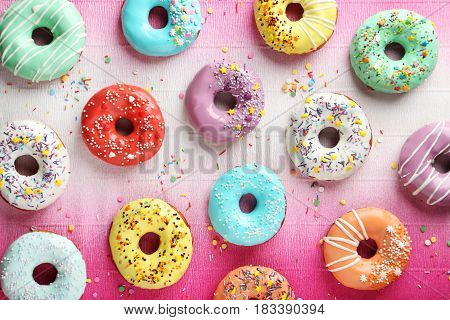 Tasty Donuts With Sprinkles On Paper Background