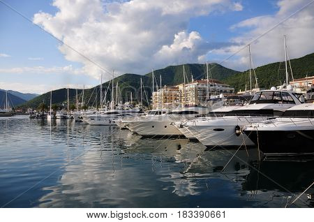 Marina with yachts in the city of Tivat in Montenegro on the shore of Kotor Bay