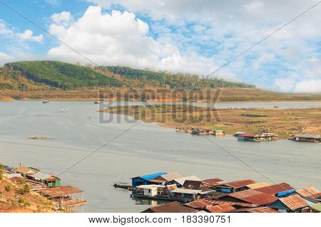 View Of Curve River And Raft House In Kanjana Buri ,thailand