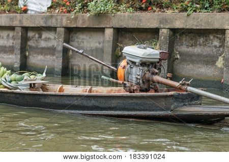 Diesel engine of Thai traditional long tail boat in floating market