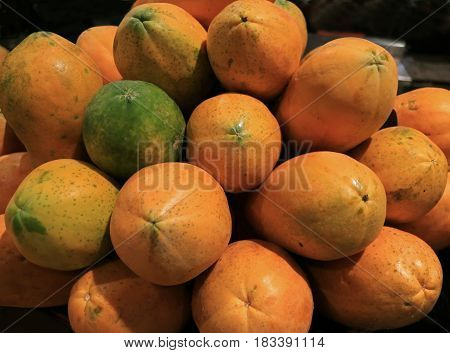 Pile of Green and Orange Color Ripe Papaya Fruits