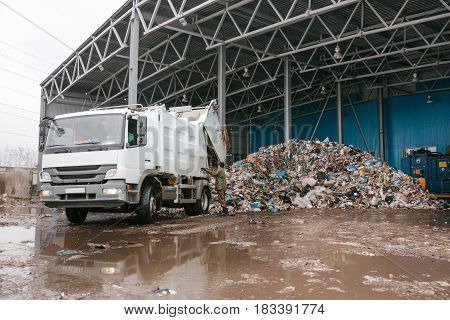 A special truck unloads waste. Transportation of waste. Technological process. Recycling and storage of waste for further disposal. Business for sorting and processing of waste.