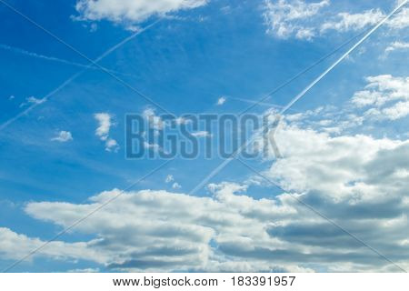 The Vast Dark Blue Sky And Puffy Clouds