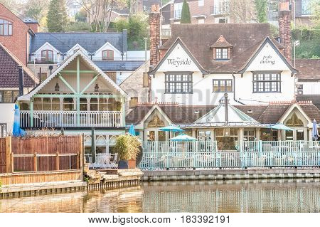 GUILDFORD, UK - APRIL 6: The popular Weyside restaurant and pub on the banks of the River Wey near Guildford, UK on April 6, 2017