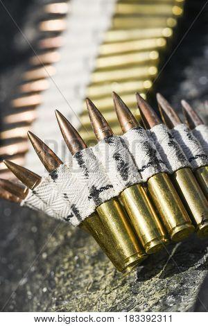 Bullets in ammunition belts outdoor for machine gun.