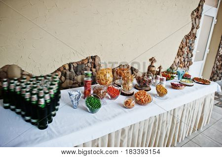 Table Catering With Beer And Snacks At Wedding Reception.