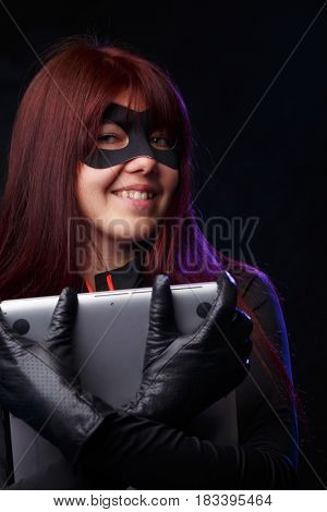 Beautiful thief in black gloves