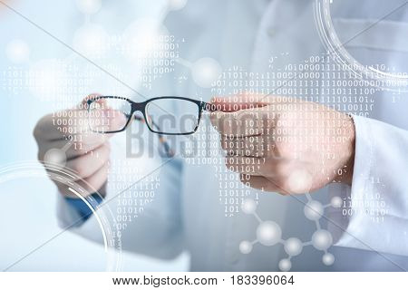 Doctor holding glasses, closeup. Ophthalmologist concept