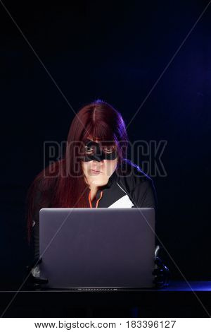 Portrait of burglar with computer