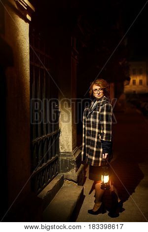 Beautiful Blonde Woman Detective In Stylish Retro Coat Holding Old Lantern, French Noire Atmosphere