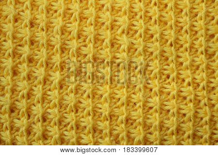 the texture of the knitted fabric with a striped drawings, yellow color