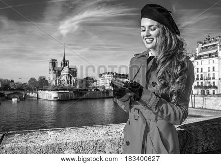 Happy Tourist Woman On Embankment In Paris Writing Sms